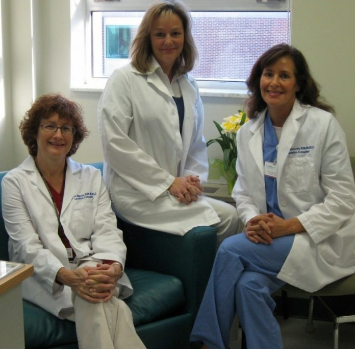 FROM LEFT, Sharon Raposa, Beth Collins and Denise McCooey, all nurses and board-certified lactation consultants at South County Hospital, work with mothers and babies to support and encourage breastfeeding. /