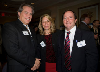 Michael Criscione(l), LGC&D, with Dee Canitez and Mickey McCabe from USI of New England. / PBN Photo/Victoria Arocho