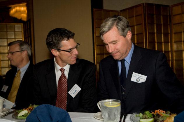 Jim Derentis(l), Bank Rhode Island, chats with U.S. Senator Sheldon Whitehouse. / PBN Photo/Victoria Arocho
