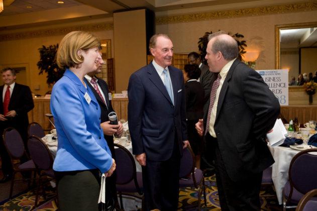 Katy Machtley(l), Bryant University President Ronald Machtley, and PBN Editor Mark Murphy. / PBN Photo/Victoria Arocho