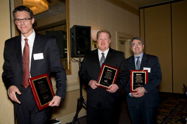 Jim Derentis(l), Bank Rhode Island, Ross Nelson, Cox Business & Chris Cassara, Partridge, Snow & Hahn, as they accept their sponsor plaques. / PBN Photo/Victoria Arocho
