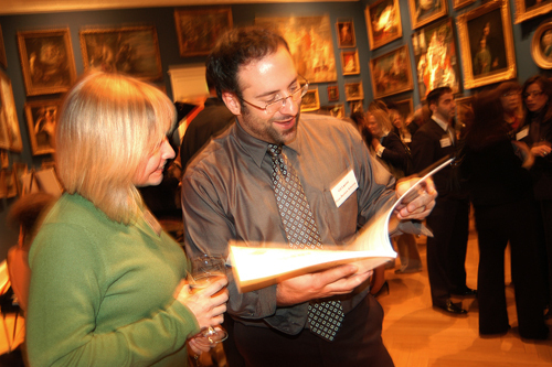 Guests enjoy referring to the 2009 Book of Lists. / PBN Photo/Frank Mullin