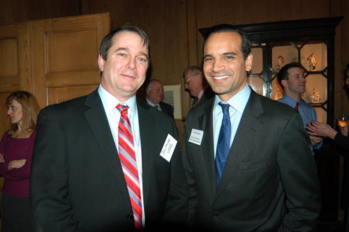 RI General Treasurer Frank Caprio, Jr. (r) and USI of New England's Jim Miller. / PBN Photo/Frank Mullin
