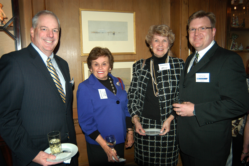 Mike Kehew(l) and Ted Larson, USI of New England, with Kathleen Connell and Barbara Peters, AARP. / PBN Photo/Frank Mullin