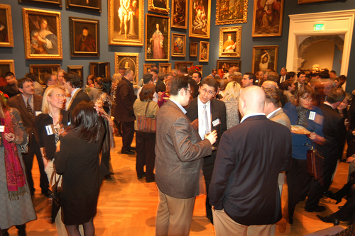 Guests network and socialize in the Museum's main gallery. / PBN Photo/Frank Mullin