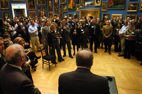 PBN Editor Mark Murphy welcomes the evening's attendees in the Museum's main gallery. / PBN Photo/Frank Mullin
