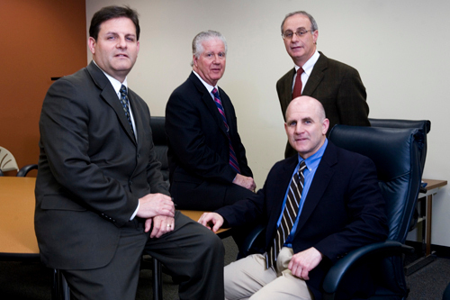 PARTNERING UP: from left, Andy Troy, David Frencis, Greg Troy and Peter Troy of Troy, Pires & Allen Insurance and Shove Insurance, which merged this year. /