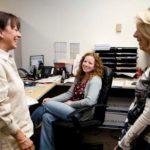 TEAM BUILDING: Shawmut Design & Construction employees Beverly Smith, left, Heidi O'Malley, center, and Nicole Blais. /