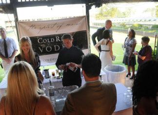 ColdRiver Vodka serves beverages to guests  / PBN PHOTO/FRANK MULLIN