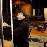 A GRAND STAGE: Mike Carcieri, a sound and lighting engineer at the RICPA Historic Park Theatre in Cranston, raises a section of lighting at the recently reopened theater. /