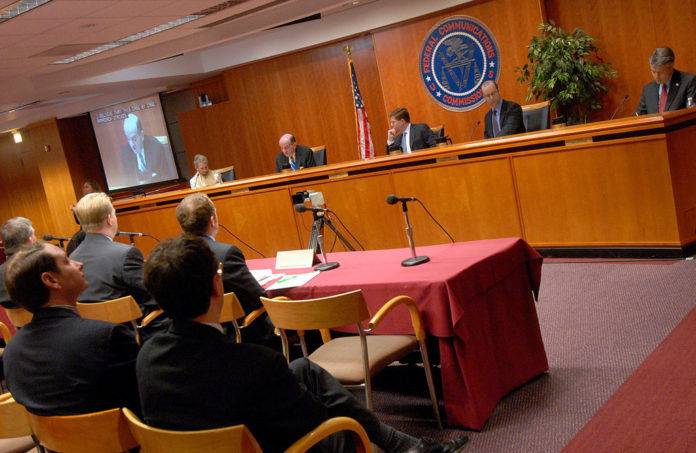 FCC COMMISSIONERS listen to testimony at a 2007 hearing on spectrum allocation in Washington, D.C. /