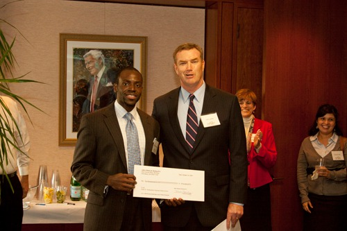 CHIKAELO N. IBEABUCHI, left, is presented with the Diversity Scholarship by John F.X. Lawler, managing shareholder of Adler Pollock & Sheehan P.C. /