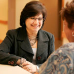 GOING HOME: Diana Franchitto, president and CEO of Home & Hospice Care of Rhode Island, left, talks with aide Delia DaCosta. /