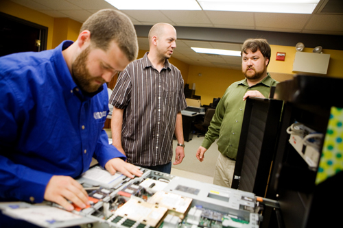 CLEAR VISION: Envision employees, from left: Purchasing Engineer Joshua DeFreitas, Systems Engineer Jason Malloney, and CEO Todd Knapp. The company saw its first big success come with Y2K consulting and has not looked back. /