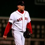 PHOTOGRAPHED during the 2007 World Series, former Red Sox star Curt Schilling has agreed to bring his video game development company, 38 Studios, to the Ocean State in exchange for a $75 million loan guarantee. /