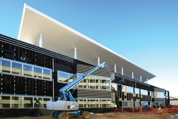 IN A JOINT VENTURE with Turner Construction, Gilbane is building a 1.2 million-square-foot hospital at Ft. Belvoir, Va., as part of the federal Base Realignment and Closing program. /