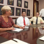 THE STRONG SURVIVE: Starkweather & Shepley employees, from left: Suzzane Chatterton, David Soforenko and Sean Cottell at a meeting with President Natale P. Calamis, standing. /