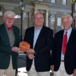 THOMAS W. KELLY, president and CEO of BankNewport, center, toured the new headquarters of Oliver Hazard Perry Rhode Island after presenting a $10,000 donation to the organization, represented by OHPRI Chairman Bart Dunbar, left, and OHPRI Vice Chairman Perry Lewis, right. /