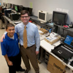 GIVING THEM A SHOT: PC Troubleshooters Inc. founder and President Eric M. Shorr, right, with company employee Leonel Padilla, who started as an intern from The Met School. /