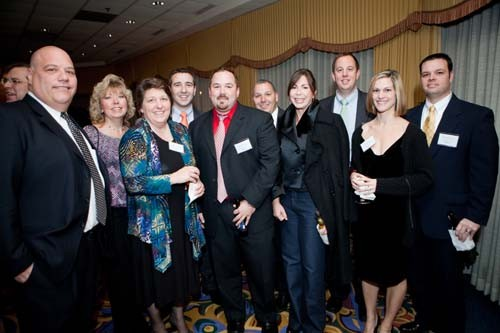 Blount Fine Foods staff enjoy the reception.