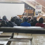 TERRY NATHAN, president of the International Yacht Restoration School, speaks to the crowd gathered Wednesday to hear the results of a study on the potential economic impact if Newport hosts the 34th America's Cup. /