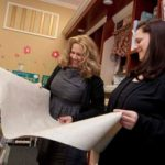 FAMILY DECISION: Donna Piscopiello, left, and her daughter, Kristen Piscopiello, discuss a wallpaper pattern at Eastern Paint Center. /