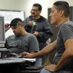 GEORGE MENDOZA, 41, a ship builder (right) looks for jobs at the South Count Career Center in Chula Vista, Calif. The U.S. jobless rate unexpectedly fell in January to the lowest level since April 2009, while payrolls rose less than forecast, depressed by winter storms. /
