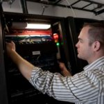BYTE IDEA: Ryan Maslar, information-services manager for AVTECH Software Inc., in the Warren company's data-storage room. The company helps others around the world protect their data in the case of a crisis. /