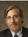 MICHAEL R. COOPER will become the new chief of Bryant University's College of Business. /