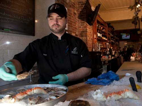 LOOKING FOR A PEARL: Providence Oyster Bar employee Ethan Fleming. The restaurant is working with the Nature Conservancy to help rebuild the local wild-oyster stock. /