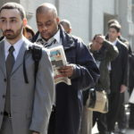 FILE PHOTO: JOB SEEKERS line up outside a career fair. Rhode Island's jobless rate fell in March to 11 percent. /
