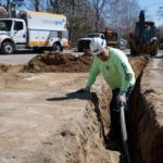 NATIONAL GRID employee installs gas lines. The utility company is the largest in Rhode Island. / PBN FILE PHOTO