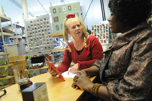 VOICE OF EXPERIENCE: Gail Ahlers, left, of Ahlers Designs Inc., discusses design options with client Ama Amponsah in Ahlers' studio in Pawtucket. /