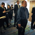 JOB seekers wait to speak to recruiters at the HireLive management and sales job fair in San Diego, Calif., on May 5. Locally, Rhode Island's unemployment rate fell below 11 percent for the first time in almost two years on Friday. /