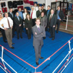 A COMBATIVE NATURE: Accutrust Mortgage CEO Don Lambert stands with some of the company's top producers at a gym where many of them train.PHOTO COURTESY ACCUTRUST/WINGATE PHOTOGRAPHY /