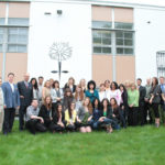 CROWN JEWEL: The staff of Alex and Ani, a Rhode Island-based company that makes eco-friendly bangle bracelets. /