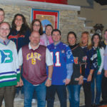 """TRUE COLORS: Employees enjoy """"Wear Your Favorite Jersey Day"""" at Province Mortgage Associates. PHOTO COURTESY PROVINCE MORTGAGE ASSOCIATES /"""