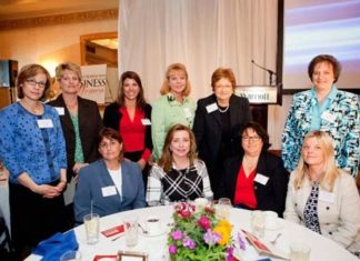 BankRI CEO Merrill Sherman with her team / Rupert Whitely