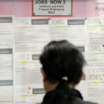A JOB seeker looks at listings on a bulletin board in the One Stop Career Link Center in San Francisco, Calif. In May, the Rhode Island jobless rate remained unchanged but the state added 1,300 jobs for the month. /