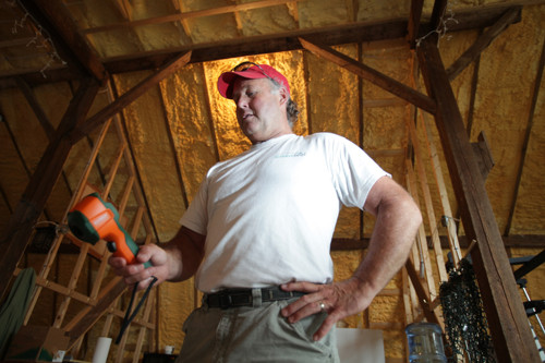 POSITIVE ENERGY: GreenSeal owner Paul Forsell in the North Kingstown barn the company calls home. The company offers retrofit services and energy audits. /