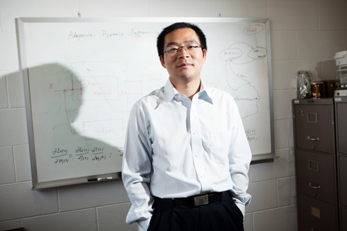 FORWARD THINKING: Haibo He, a researcher at the University of Rhode Island College of Engineering, is leading a team that specializes in complex mathematical formulas that attempt to have computers mimic the human brain. / PBN PHOTO/RUPERT WHITELEY