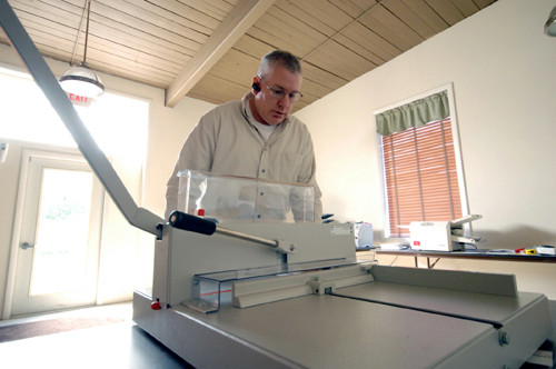 SPECIAL DELIVERY: Don Dumont of Millennium Mailing Equipment, with one of the company's mail-processing machines. Millennium's machines are used in many law firms, medical offices and government agencies. / PBN FILE PHOTO/BRIAN MCDONALD