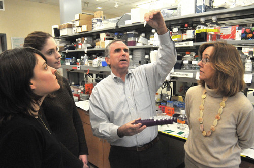 TEAMWORK: Brown University neuroscience professor Justin Fallon, second from right, with members of his research team, from left: Alison Amenta, Carolyn Schmiedel and Beth McKechnie. The team is searching for a treatment for Duchenne Muscular Dystrophy. / PBN PHOTO/FRANK MULLIN