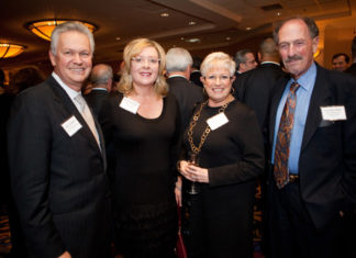 John Bowen, Chancellor of Johnson & Wales University, stands with Kathleen Harney, Johnson & Wales University, and Esta and Gerald Cohen from Bryant University's Chafee Center / Ruppert Whitely