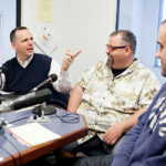 "BEHIND THE MIC: Pawtucket Mayor Donald R. Grebien, left, interviews city restaurateurs Jack Doherty and Brandon Harnois, right, for his weekly radio show, ""The Mayor's Corner."" / PBN PHOTO/RUPERT WHITELEY"
