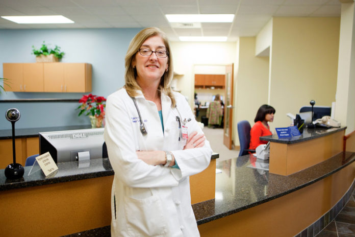"COLLABORATIVE EFFORT: Margaret ""Peg"" Miller is director of the Women's  Medicine Collaborative, which now  includes some 23 providers. / PBN PHOTO/RUPERT WHITELEY"