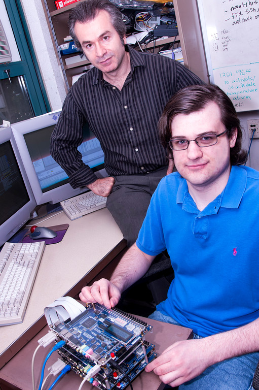 Resit Sendag, lrft, University of Rhode Island professor of computer engineering, and URI graduate student Will Simoneau. / COURTESY URI