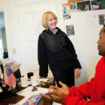 HOUSE BECOMES A HOME: Eileen Hayes, president and CEO of Amos House, speaks with case manager Sonny Ramsey. She oversees a staff of 55. / PBN FILE PHOTO/RUPERT WHITELEY