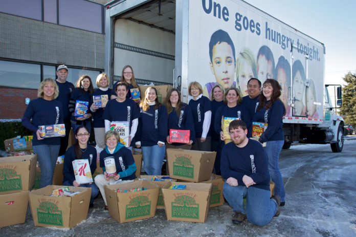FEEDING A NEED: BankNewport's employees pitched in to collect more than three-quarters-of-a-ton of food for the Rhode Island Community Food Bank over the winter. / Courtesy BankNewport