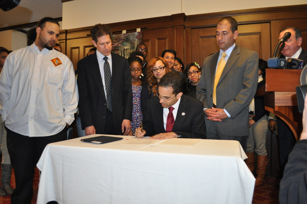LEADERS OF the largest U.S. union of public-sector workers are vowing to fight efforts by state and local governments to balance their budgets with cuts to employee benefits even as voters have sided with that strategy. Above: Angel Taveras, mayor of Providence, center, signs an ordinance to overhaul the city's pension system and reduce its cost. / BLOOMBERG FILE PHOTO